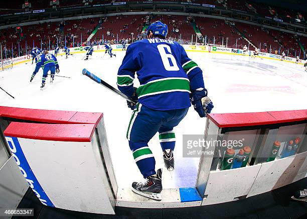 Yannick Weber of the Vancouver Canucks steps onto the ice during their NHL game against the Calgary Flames at Rogers Arena January 18 2014 in...