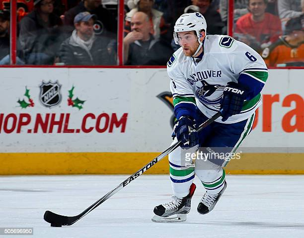 Yannick Weber of the Vancouver Canucks takes the puck against the Philadelphia Flyers on December 17 2015 at the Wells Fargo Center in Philadelphia...