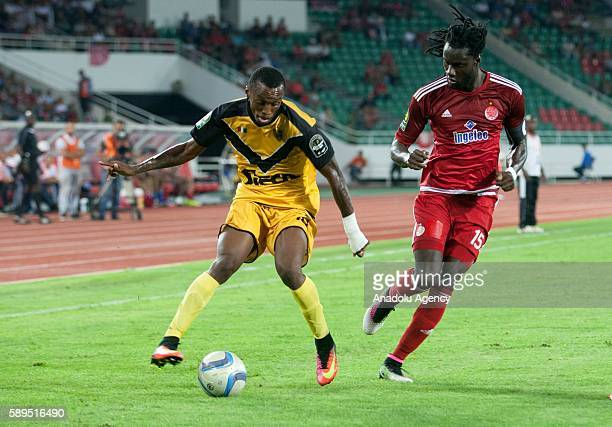 Yannick Zakri of ASEC and Mourtada Fall of Wydad Casablanca vie for the ball during the Group A match of CAF Champions League between Wydad...