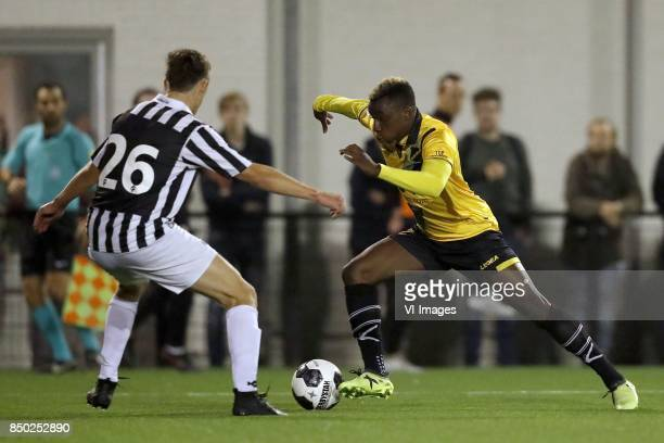 Yannick Zeeman of Achilles 29 Thierry Ambrose of NAC Breda during the First round Dutch Cup match between Achilles 29 and NAC Breda at Sportpark de...