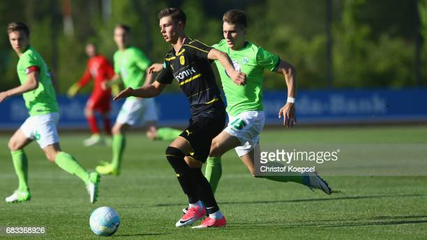 Yannik Moeker of Wolfsburg challenges Alexander Laukart of Dortmund during the U19 German Championship Semi Final second leg match between Borussia...