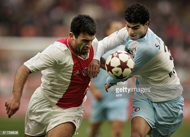 Yannis Anastasiou from Ajax vies for the ball with Karim Saidi from Feyenoord during their football match of the Dutch premier league 14 November...