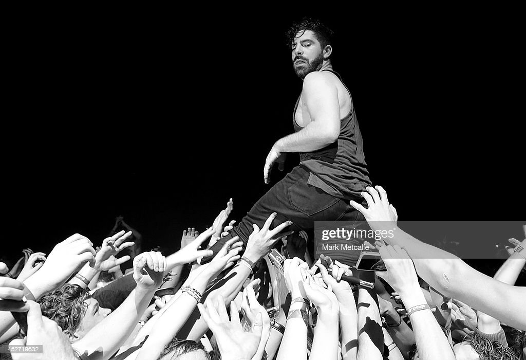Yannis Phiippakis of Foals performs in the crowd at Splendour In the Grass 2014 on July 26 2014 in Byron Bay Australia