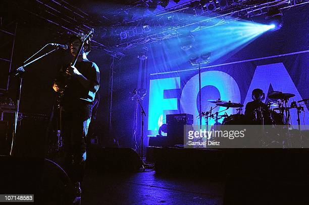 Yannis Philippakis and Jack Bevan of British band Foals perform at Elysee Montmartre on November 25 2010 in Paris France