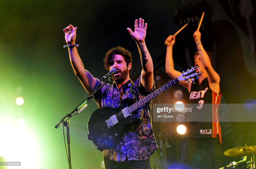 Yannis Philippakis and Jack Bevan of Foals perform on the Other stage during day 2 of the 2013 Glastonbury Festival at Worthy Farm on June 28, 2013 in Glastonbury, England.