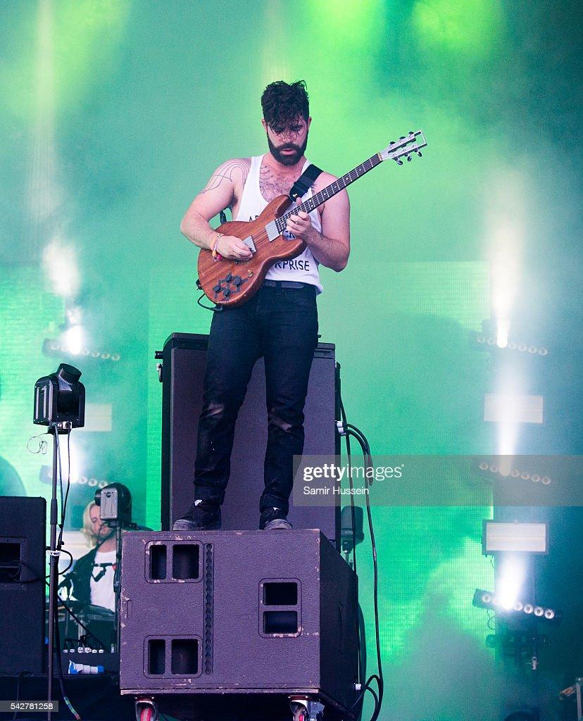 Yannis Philippakis of Foals performs on the Pyramid Stage Glastonbury Festival 2016 at Worthy Farm Pilton on June 24 2016 in Glastonbury England