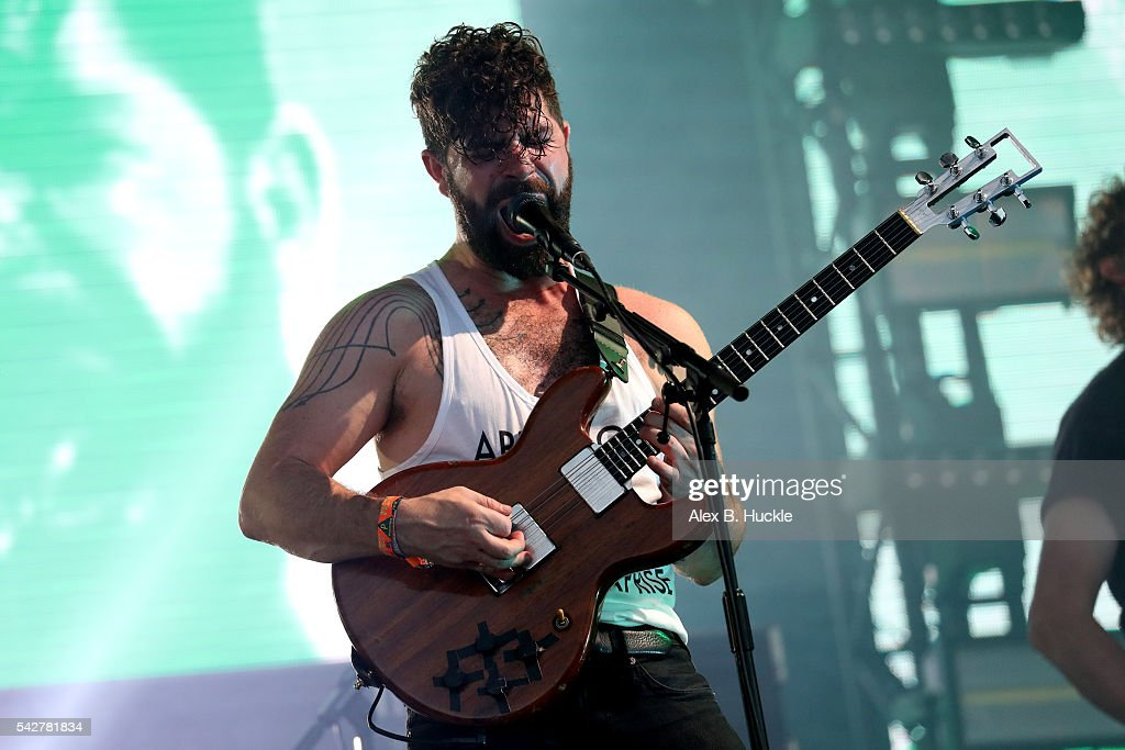 <a gi-track='captionPersonalityLinkClicked' href=/galleries/search?phrase=Yannis+Philippakis&family=editorial&specificpeople=4453909 ng-click='$event.stopPropagation()'>Yannis Philippakis</a> of the band Foals performs on The Pyramid Stage at Glastonbury Festival at Worthy Farm, Pilton on June 24, 2016 in Glastonbury, England.