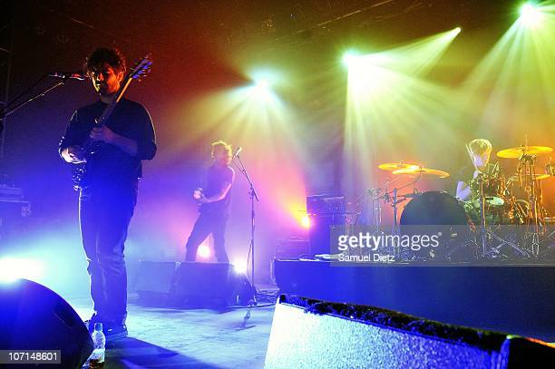 Yannis Philippakis Walter Gervers and Jack Bevan of British band Foals performs at Elysee Montmartre on November 25 2010 in Paris France