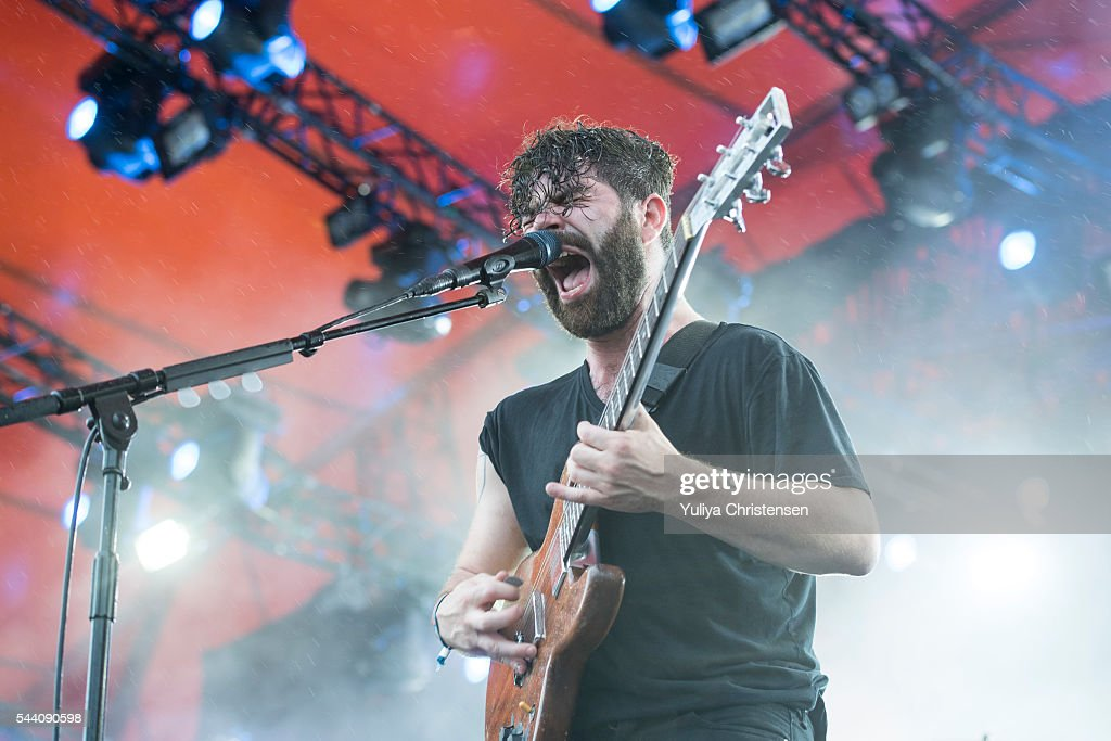 <a gi-track='captionPersonalityLinkClicked' href=/galleries/search?phrase=Yannis+Philippakis&family=editorial&specificpeople=4453909 ng-click='$event.stopPropagation()'>Yannis Philippakis</a> with Foals performs at Roskilde Festival on July 1, 2016 in Roskilde, Denmark.