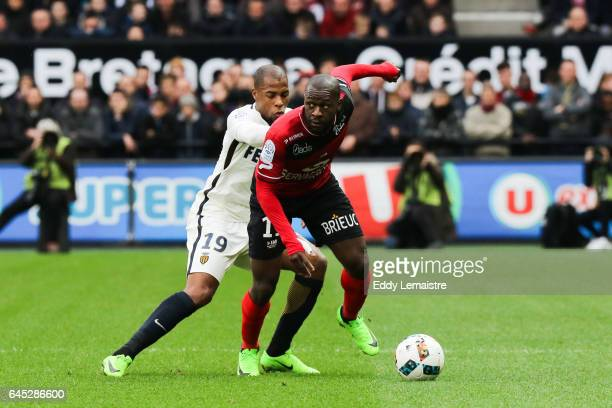Yannis Salibur of Guingamp and Djibril Sidibe of Monaco during the French Ligue 1 match between Guingamp and Monaco at Stade du Roudourou on February...