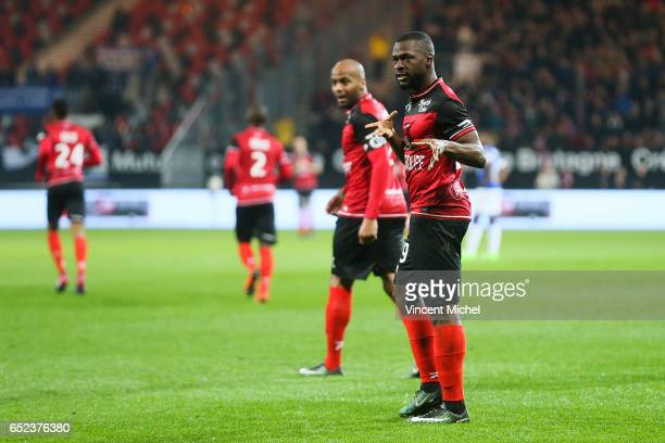 Yannis Salibur of Guingamp jubilates with teammates after scoring the first goal during the Ligue 1 match between EA Guingamp and SC Bastia at Stade...