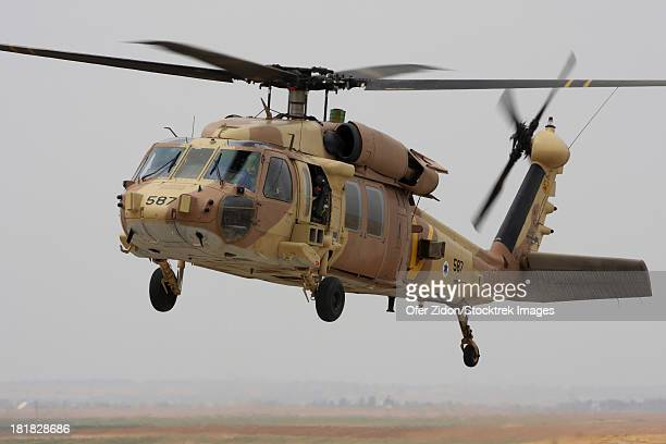 A UH-60L Yanshuf helicopter landing at Hatzerim Air Force Base, Israel.