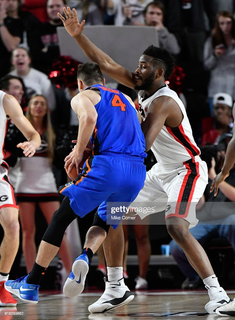 Yante Maten #1 of the Georgia Bulldogs defends Egor Koulechov #4 of the Florida Gators during the basketball game at Stegeman Coliseum on January 30, 2018 in Athens, Georgia.