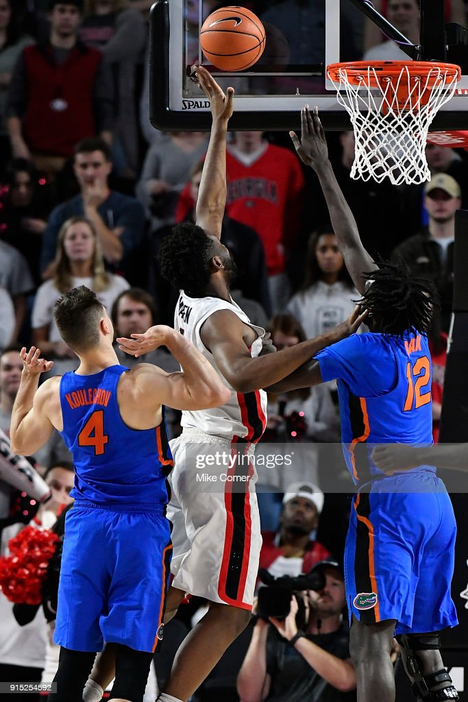 Yante Maten #1 of the Georgia Bulldogs drives to the basket over Gorjok Gak #12 of the Florida Gators during the basketball game at Stegeman Coliseum on January 30, 2018 in Athens, Georgia.