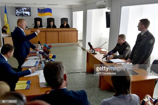 Yanukovychs lawers and prosecutors talk in front of a panel of threejudges in Kiev on June 26 on the first day of hearing the merits of the case of...