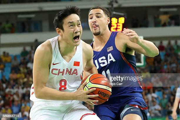 Yanyuhang Ding of China drives the ball around Klay Thompson of United States on Day 1 of the Rio 2016 Olympic Games at Carioca Arena 1 on August 6...