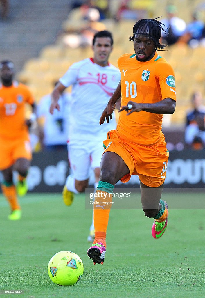 AFRICA - JANUARY 26, Yao <a gi-track='captionPersonalityLinkClicked' href=/galleries/search?phrase=Gervinho&family=editorial&specificpeople=4500752 ng-click='$event.stopPropagation()'>Gervinho</a> of Ivory Coast attacks during the 2013 African Cup of Nations match between Ivory Coast and Tunisia at Royal Bafokeng Stadium on January 26, 2013 in Rustenburg, South Africa.