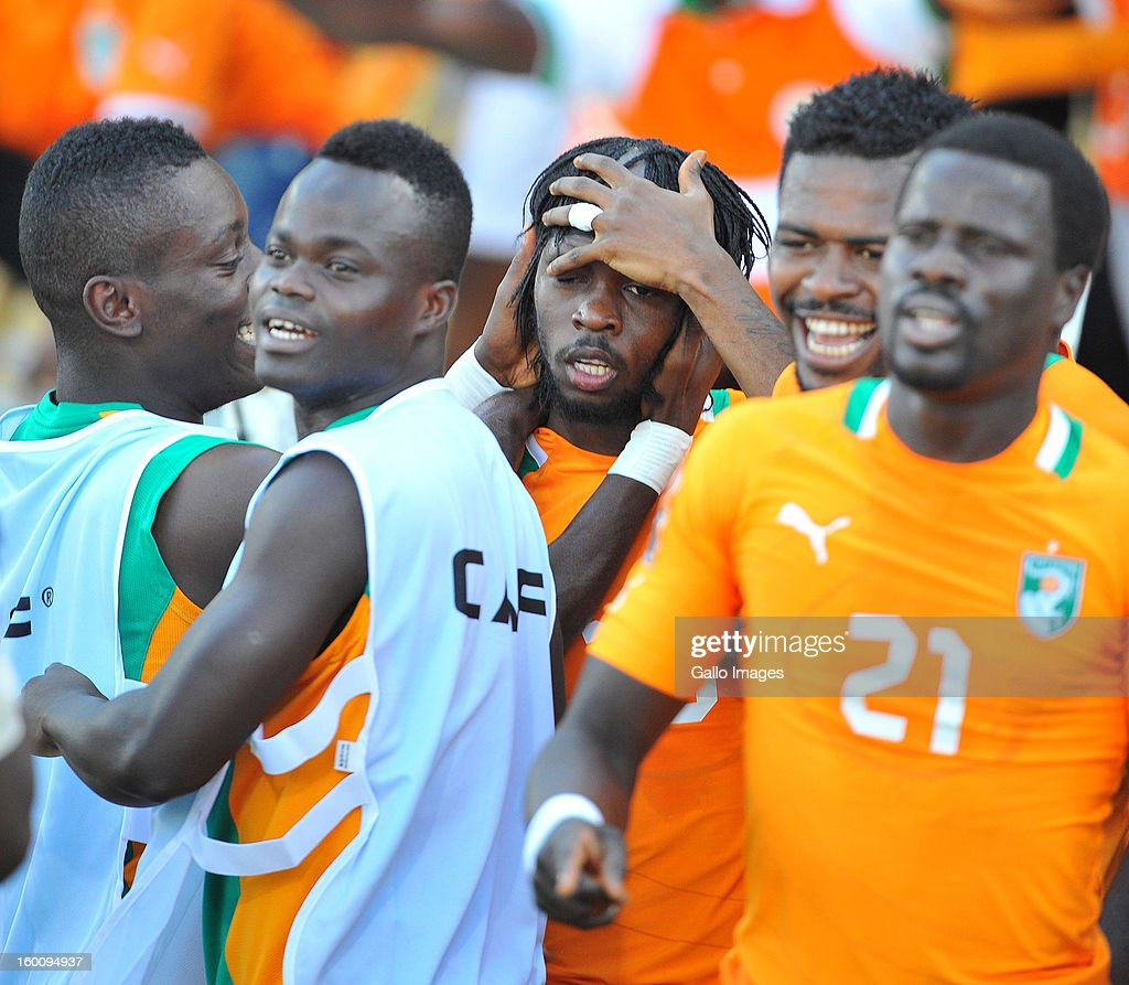 AFRICA - JANUARY 26, Yao <a gi-track='captionPersonalityLinkClicked' href=/galleries/search?phrase=Gervinho&family=editorial&specificpeople=4500752 ng-click='$event.stopPropagation()'>Gervinho</a> of Ivory Coast (hand on head) celebrates his goal during the 2013 African Cup of Nations match between Ivory Coast and Tunisia at Royal Bafokeng Stadium on January 26, 2013 in Rustenburg, South Africa.