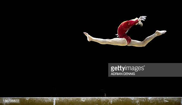 Yao Jinnan of China performs on the beam during the women's qualification of the Artistic International Gymnastics London 2012 Olympic qualifier a...