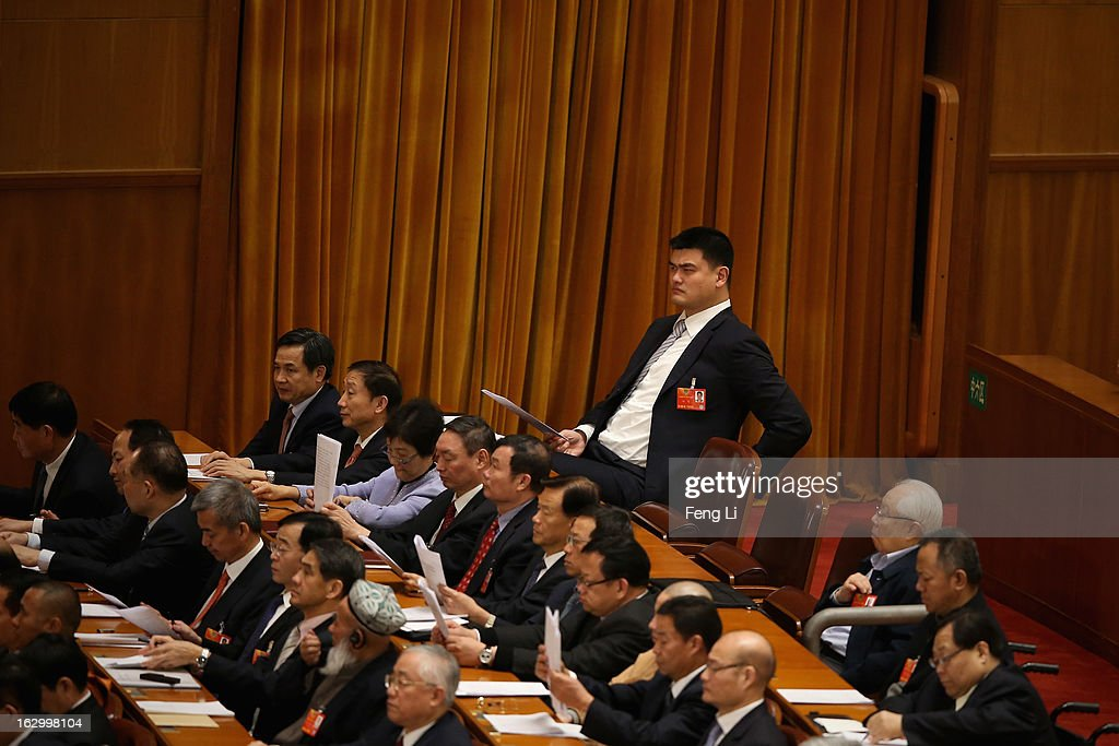 <a gi-track='captionPersonalityLinkClicked' href=/galleries/search?phrase=Yao+Ming&family=editorial&specificpeople=201476 ng-click='$event.stopPropagation()'>Yao Ming</a> (Top Right), a former NBA basketball star and a delegate to the Chinese People's Political Consultative Conference, attends the opening session of the Chinese People's Political Consultative Conference in Beijing's Great Hall of the People on March 3, 2013 in Beijing, China.