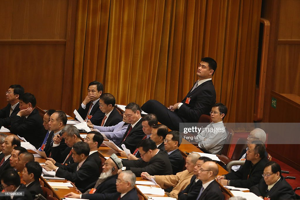 Yao Ming (Top Right), a former NBA basketball star and a delegate to the Chinese People's Political Consultative Conference, attends the opening session of the Chinese People's Political Consultative Conference in Beijing's Great Hall of the People on March 3, 2013 in Beijing, China.