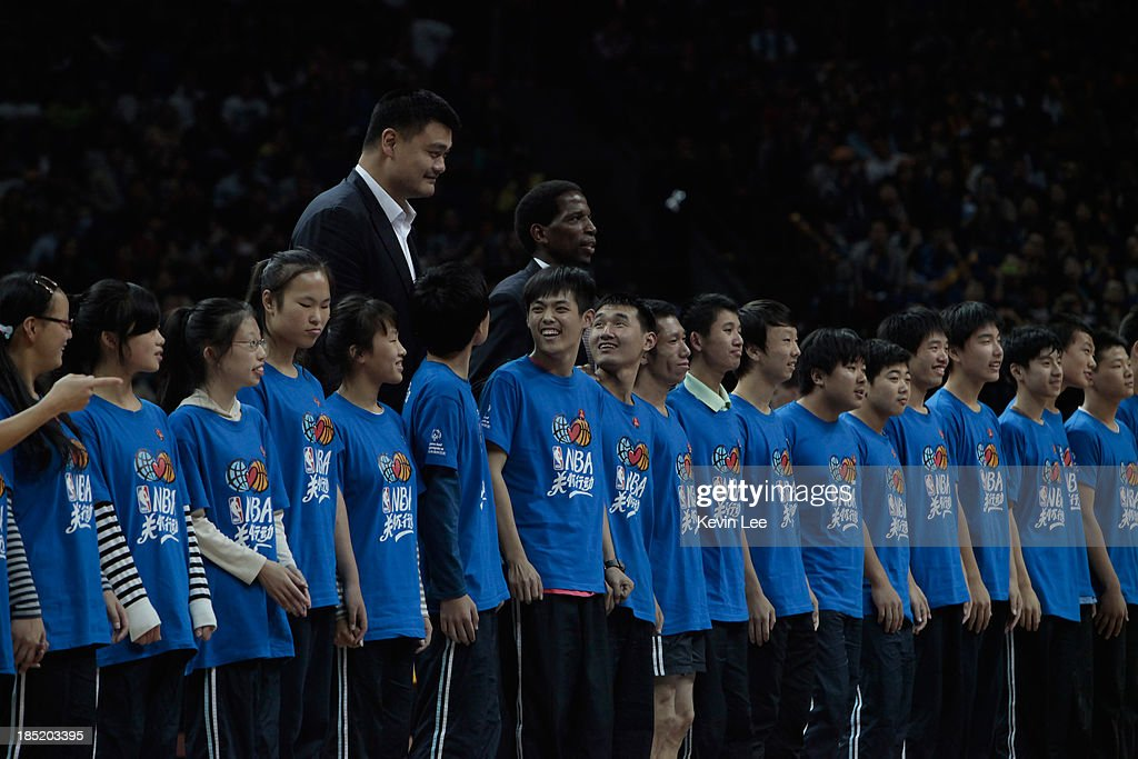 <a gi-track='captionPersonalityLinkClicked' href=/galleries/search?phrase=Yao+Ming&family=editorial&specificpeople=201476 ng-click='$event.stopPropagation()'>Yao Ming</a> and <a gi-track='captionPersonalityLinkClicked' href=/galleries/search?phrase=A.C.+Green&family=editorial&specificpeople=220773 ng-click='$event.stopPropagation()'>A.C. Green</a> pose for a picture with kids in the NBA match between the Los Angeles Lakers and the Golden State Warriors on October 18, 2013 in Shanghai, China.