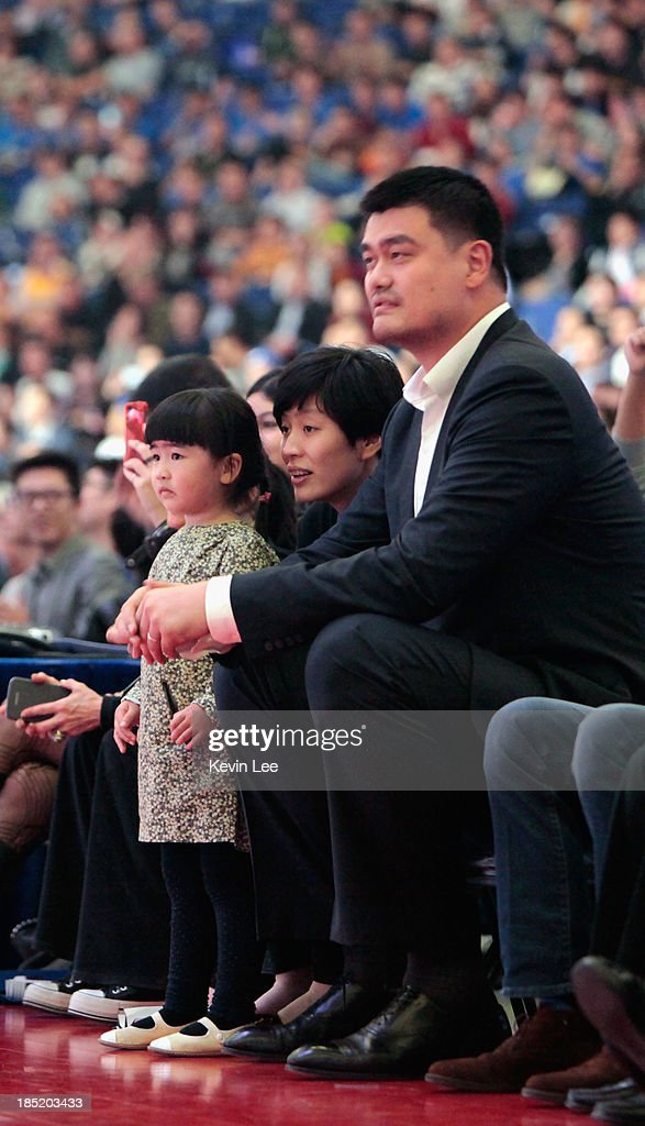 <a gi-track='captionPersonalityLinkClicked' href=/galleries/search?phrase=Yao+Ming&family=editorial&specificpeople=201476 ng-click='$event.stopPropagation()'>Yao Ming</a> and his famiy watch the NBA match between the Los Angeles Lakers and the Golden State Warriors on October 18, 2013 in Shanghai, China.