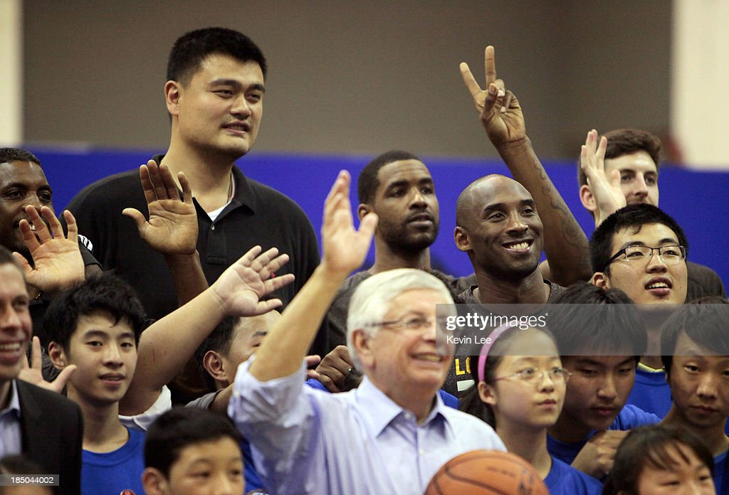 <a gi-track='captionPersonalityLinkClicked' href=/galleries/search?phrase=Yao+Ming&family=editorial&specificpeople=201476 ng-click='$event.stopPropagation()'>Yao Ming</a> (L) and <a gi-track='captionPersonalityLinkClicked' href=/galleries/search?phrase=Kobe+Bryant&family=editorial&specificpeople=201466 ng-click='$event.stopPropagation()'>Kobe Bryant</a> pose for a group photo during NBA Fan Appreciation Day on October 17, 2013 in Shanghai, China.