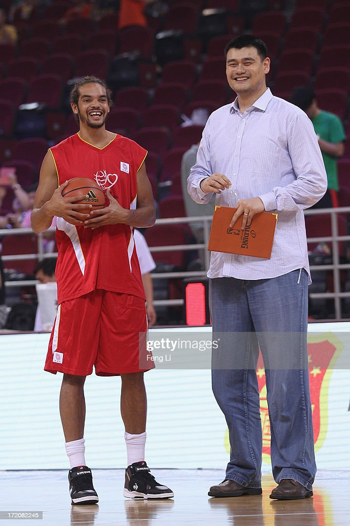Yao Ming (R) and NBA star Joakim Noah talk before the 2013 Yao Foundation Charity Game between China team and the NBA Stars team on July 1, 2013 in Beijing, China.