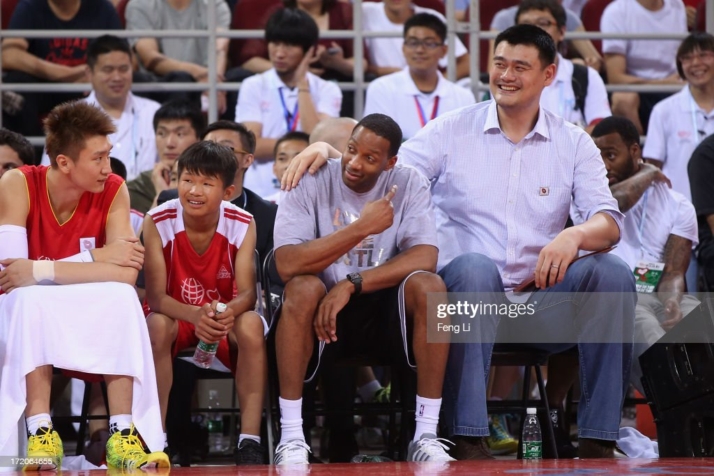 Yao Ming (R) and NBA star Tracy McGrady watch the Yao Foundation Charity Game, sponsored by the charity foundation initiated by former Chinese basketball star Yao Ming, during the 2013 Yao Foundation Charity Game between China team and the NBA Stars team on July 1, 2013 in Beijing, China.