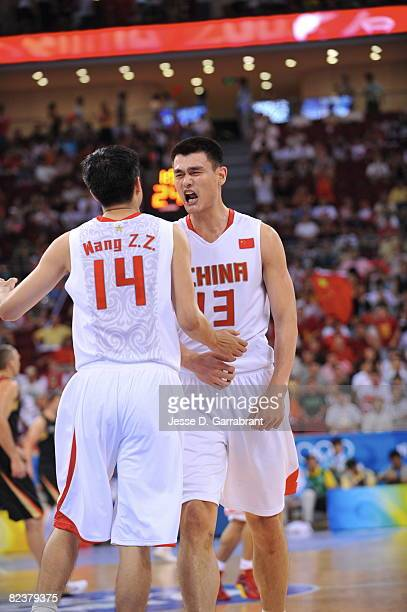 Yao Ming and Wang Zhizhi of China celebrate against Germany during the group B preliminary basketball game at the Beijing Olympic Basketball...
