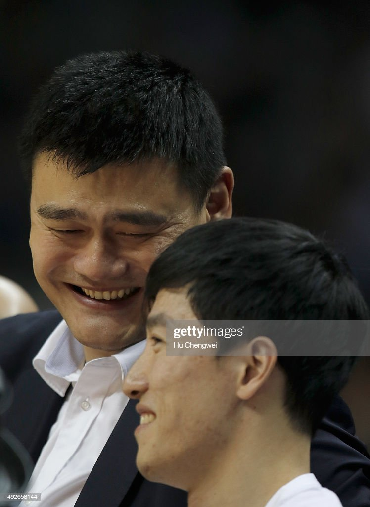 Yao Ming, left, and Liu Xiang, right, react during a NBA game between Charlotte Hornets and Los Angeles Clippers at Mercedes-Benz Arena on October 14, 2015 in Shanghai, China.