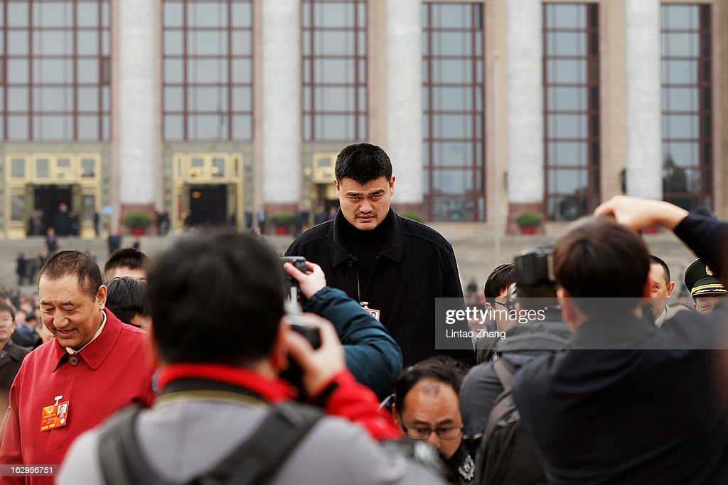 <a gi-track='captionPersonalityLinkClicked' href=/galleries/search?phrase=Yao+Ming&family=editorial&specificpeople=201476 ng-click='$event.stopPropagation()'>Yao Ming</a>, NBA basketball star and a delegate to the Chinese People's Political Consultative Conference (CPPCC), walks outside the Great Hall of the People after the pre-opening session of the Chinese People's Political Consultative Conference on March 2, 2013 in Beijing, China. The reshuffle will be completed at the first annual session of the 12th National People's Congress (NPC), which is scheduled to begin on March 5, and the first annual session of the 12th National Committee of the Chinese People's Political Consultative Conference (CPPCC), which will commence on March 3.