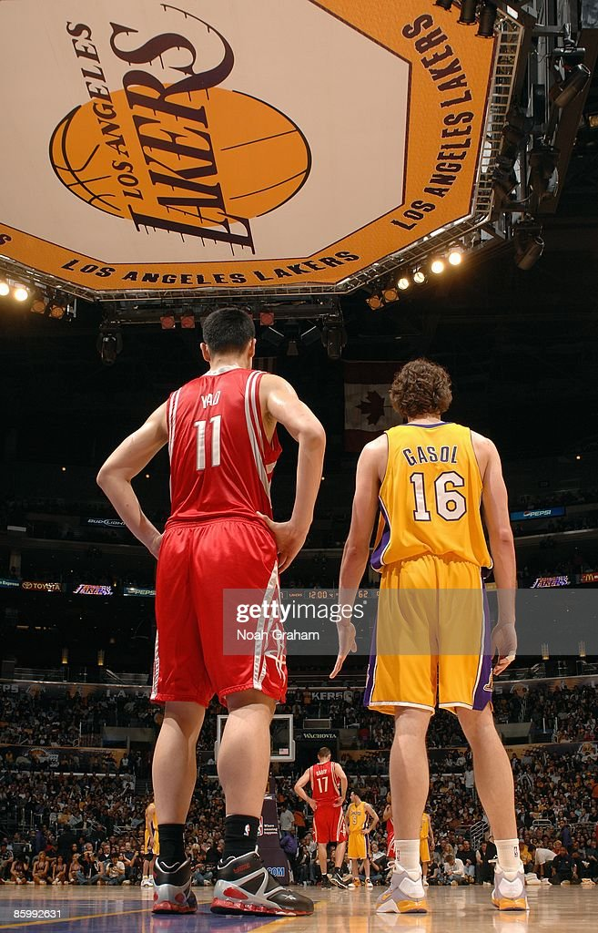 Yao Ming #11 of the Houston Rockets and Pau Gasol #16 of the Los Angeles Lakers stand on the court during the game on April 3, 2009 at Staples Center in Los Angeles, California. The Lakers won 93-81.