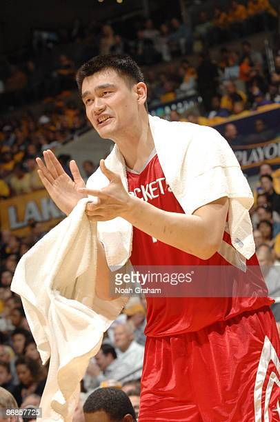 Yao Ming of the Houston Rockets cheers on his teammates from the sideline in Game One of the Western Conference Semifinals during the 2009 NBA...