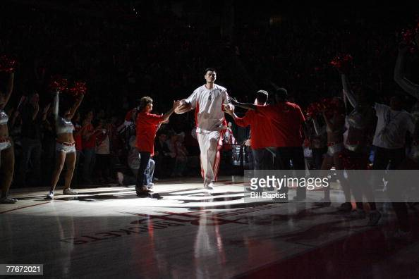 Yao Ming of the Houston Rockets gives high fives as he is introduced before the Houston Rockets first home game on November 3 2007 at the Toyota...