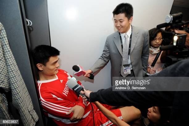 Yao Ming of the Houston Rockets is interviewed by NBAcom China reporter Mo Wang prior to the game against the Los Angeles Lakers at Staples Center on...