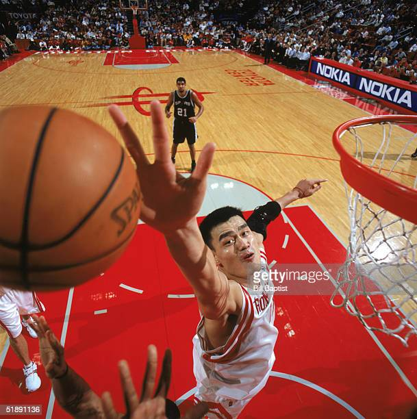 Yao Ming of the Houston Rockets moves for the ball against the San Antonio Spurs at Toyota Center on December 9 2004 in Houston Rockets The Rockets...