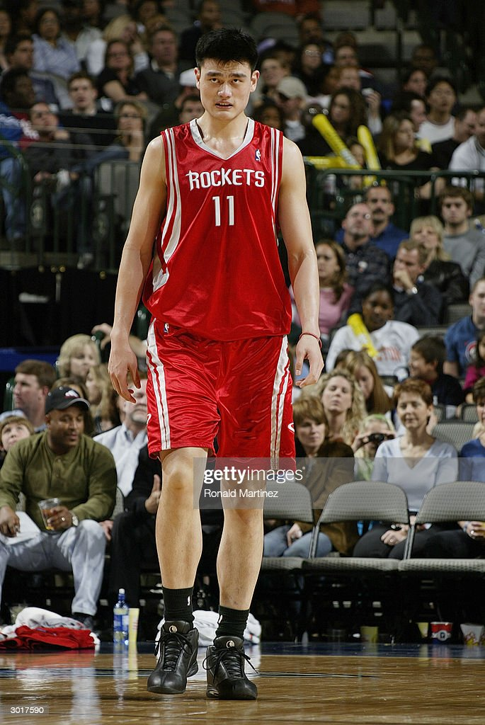 Yao Ming #11 of the Houston Rockets on the court during the game against the Dallas Mavericks on February 21, 2004 at American Airlines Center in Dallas, Texas. The Mavericks won 97-88.