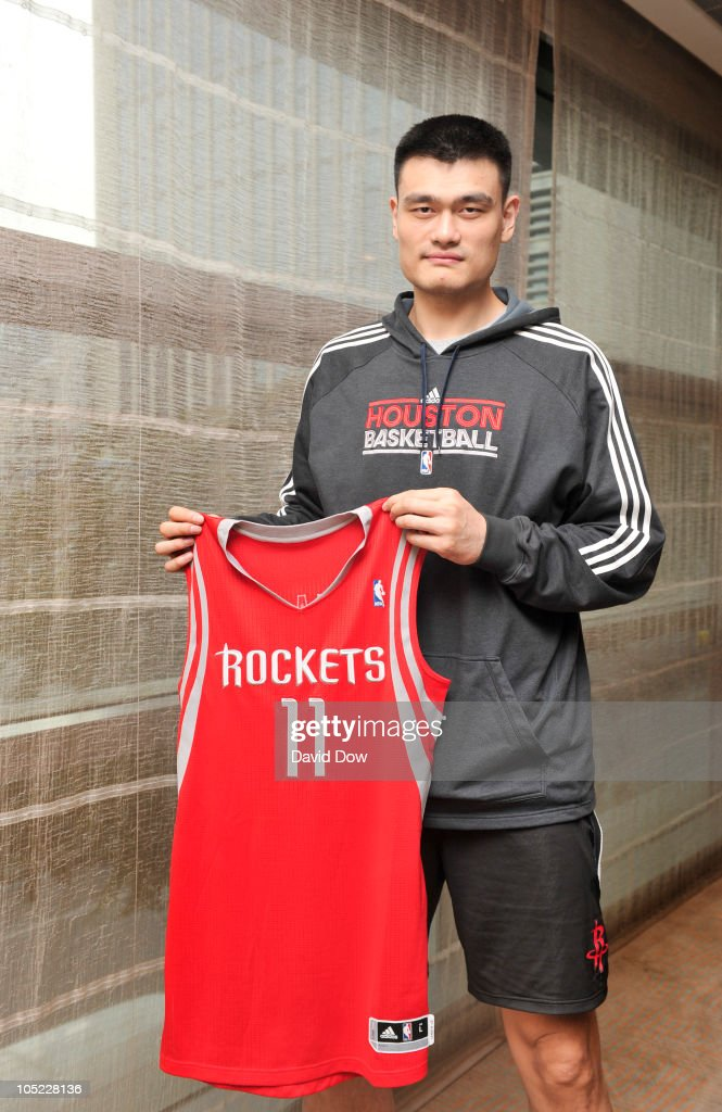 <a gi-track='captionPersonalityLinkClicked' href=/galleries/search?phrase=Yao+Ming&family=editorial&specificpeople=201476 ng-click='$event.stopPropagation()'>Yao Ming</a> of the Houston Rockets poses for a photograph with his new Adidas Jersey during the Adidas media event at the Ritz Carlton Hotel on October 12, 2010 in Beijing, China.