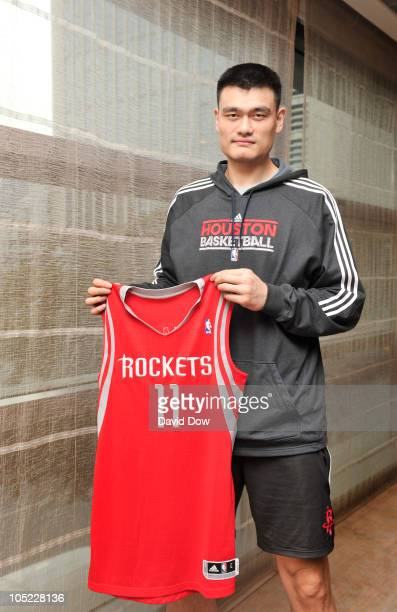 Yao Ming of the Houston Rockets poses for a photograph with his new Adidas Jersey during the Adidas media event at the Ritz Carlton Hotel on October...