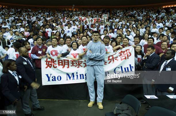 Yao Ming of the Houston Rockets poses with fans following a game against the Milwaukee Bucks as the Rockets defeated the Bucks 10380 at the Compaq...