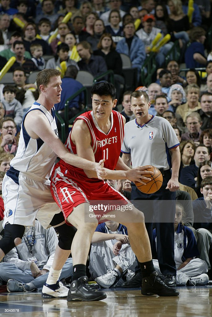 Yao Ming #11 of the Houston Rockets posts up Shawn Bradley #44 of the Dallas Mavericks during the game at the American Airlines Arena on February 21, 2004 in Dallas, Texas. The Mavericks won 97-88.