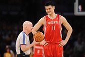 Yao Ming of the Houston Rockets shares a laugh with referee Joe Crawford prior to Game Two of the Western Conference Semifinals against the Los...