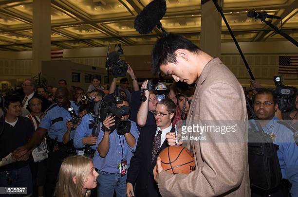 Yao Ming of the Houston Rockets signs autographs for fans upon his arrival at Houston Intercontinental Airport on October 20 2002 in Houston Texas...
