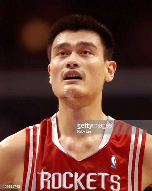 Yao Ming of the Houston Rockets walks onto the court during the NBA game between the Los Angeles Lakers and the Houston Rockets at the Staples Center...