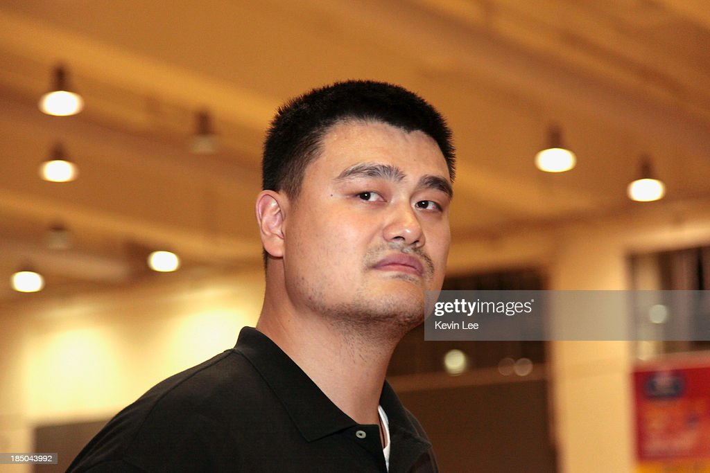 <a gi-track='captionPersonalityLinkClicked' href=/galleries/search?phrase=Yao+Ming&family=editorial&specificpeople=201476 ng-click='$event.stopPropagation()'>Yao Ming</a> walks to the practice court during NBA Fan Appreciation Day on October 17, 2013 in Shanghai, China.