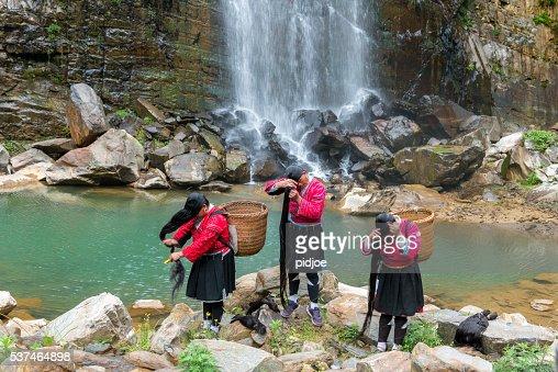 Yao Tribe Women Washing Long Hair at Waterfall, Longsheng, China