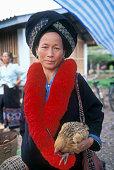 Yao Woman Holding Chicken