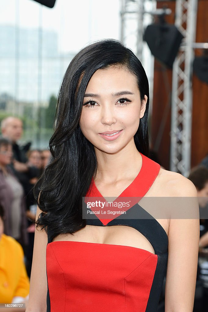 Yao Xingtong attends the Maxime Simoens show as part of the Paris Fashion Week Womenswear Spring/Summer 2014 at Orangerie du Parc Andre Citroen on September 29, 2013 in Paris, France.